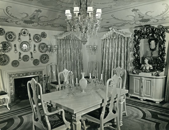 Dining room: Claggett Wilson designed the furniture, rug, lighting, murals et cetera